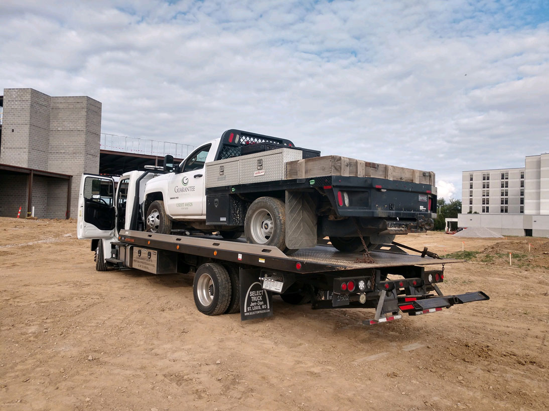 cliffs_towing_service_flatbed_with_1_ton_dually_on_flatbed.jpg