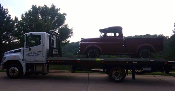 cliffs_towing_service_flatbed_vintage_old_truck_strapped